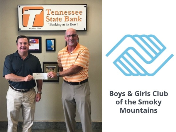Todd Proffitt, CEO hands check to Boys & Girls Club Director